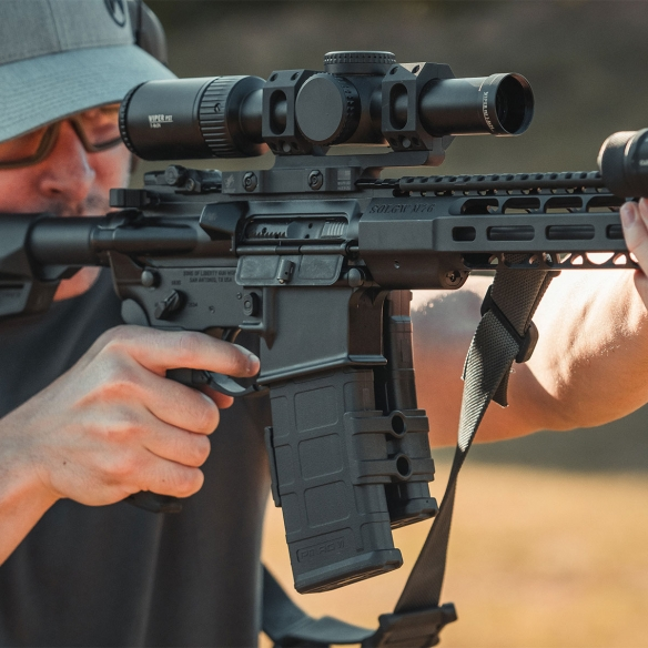 Magpul Maglink for PMAG GEN M2 on an AR15 being shot by a man wearing Magpul Sunglasses
