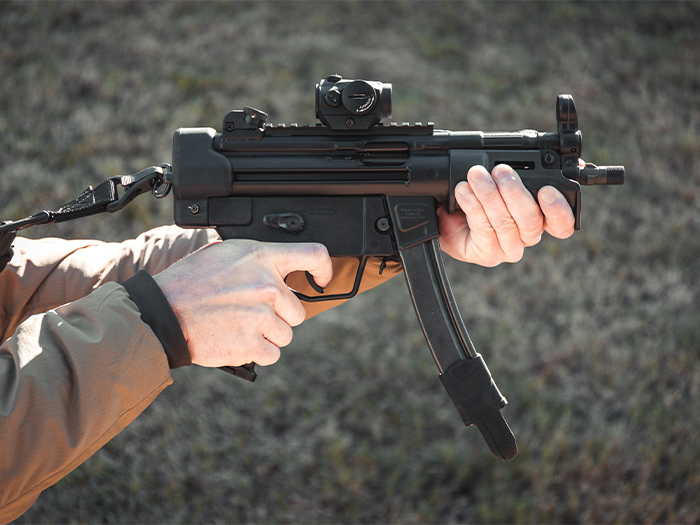 SL Hand Guard MP5K on a HK pistol being held showing use of large muzzle-end hand stop similar to the HK K-style handguard