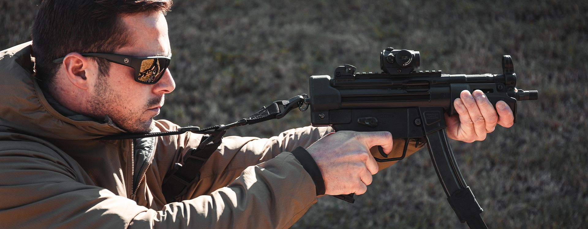 SL Hand Guard MP5K on a HK pistol with SL Grip Module, ESK, 9mm Magpul, and MS3 Sling being fired by a man with Magpul glasses