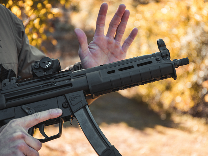 Magpul SL Hand Guard MP5, SL Grip Module, and ESK on a gun with its charging handle being slapped