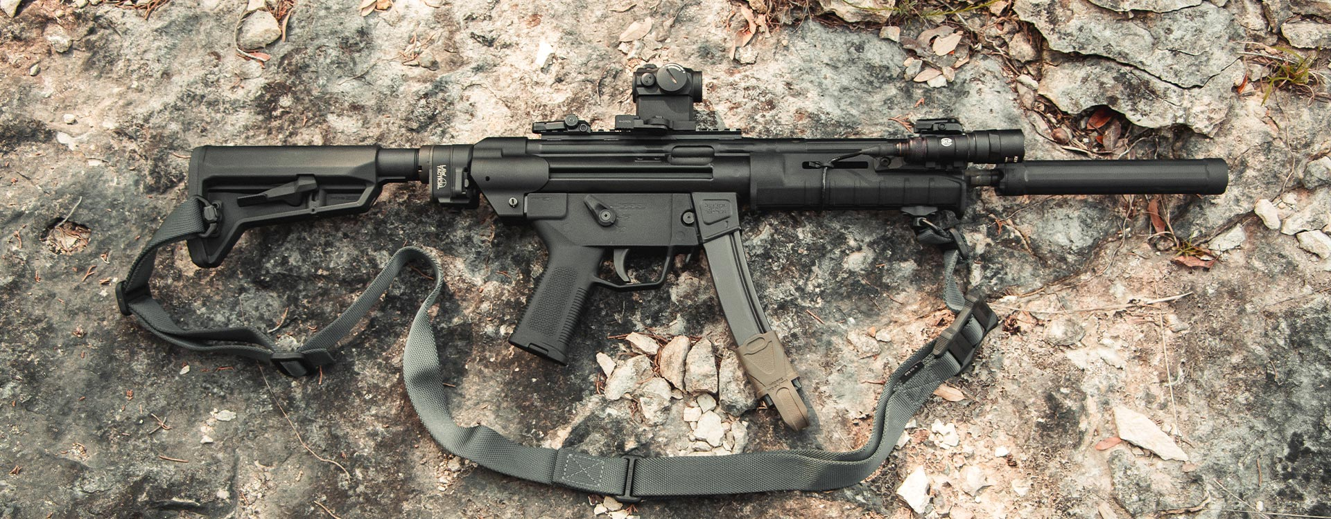 Magpul SL Grip Module on an MP5 with ESK, SL Hand Guard, SL-K Stock, 9mm Magpul, and MS4 QDM Sling on a rock background