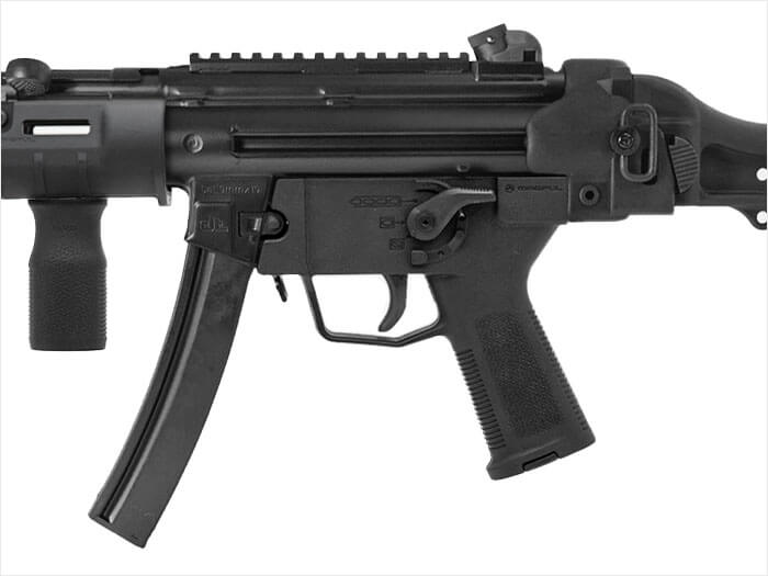 Left side view of Magpul ESK on a closeup of an MP5 with an SL Grip Module showing the easier firing hand access to selector lever