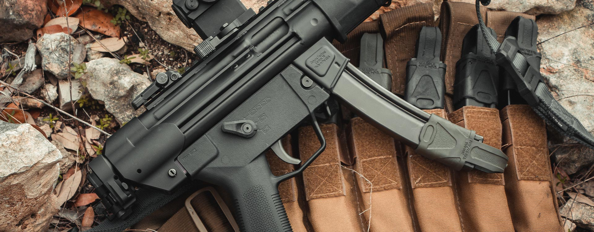 Magpul ESK on an MP5 with SL Grip Module, laying on pouch of mags with 9mm Subgun Magpuls