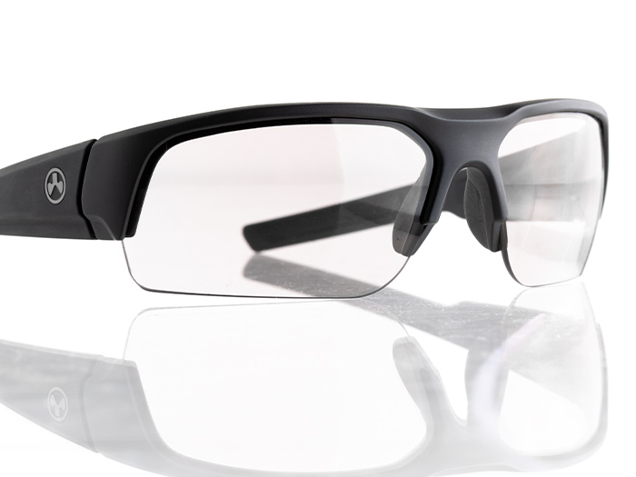 Angled front view of clear lens Magpul Helix Eyewear showing its interchangeable lens design and rubber nose pads
