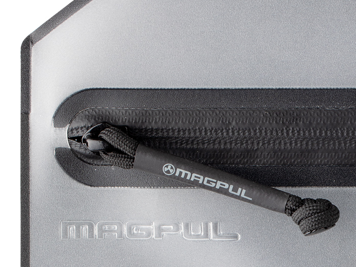 Detail of Magpul DAKA Volume Pouch's zipper showing 550 paracord and logoed heat shrink tubing for enhanced grip