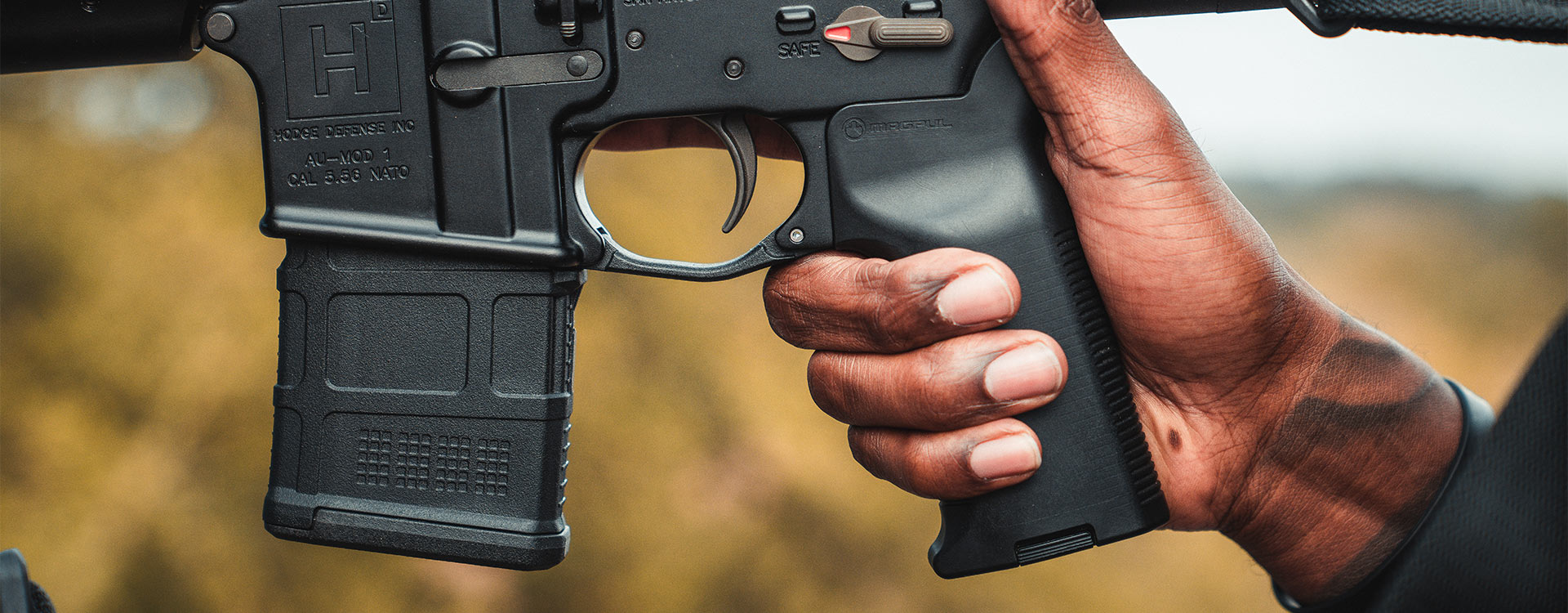 Closeup side view of Magpul MOE K2-XL in hand on gun showing hand placement with the more vertical grip angle