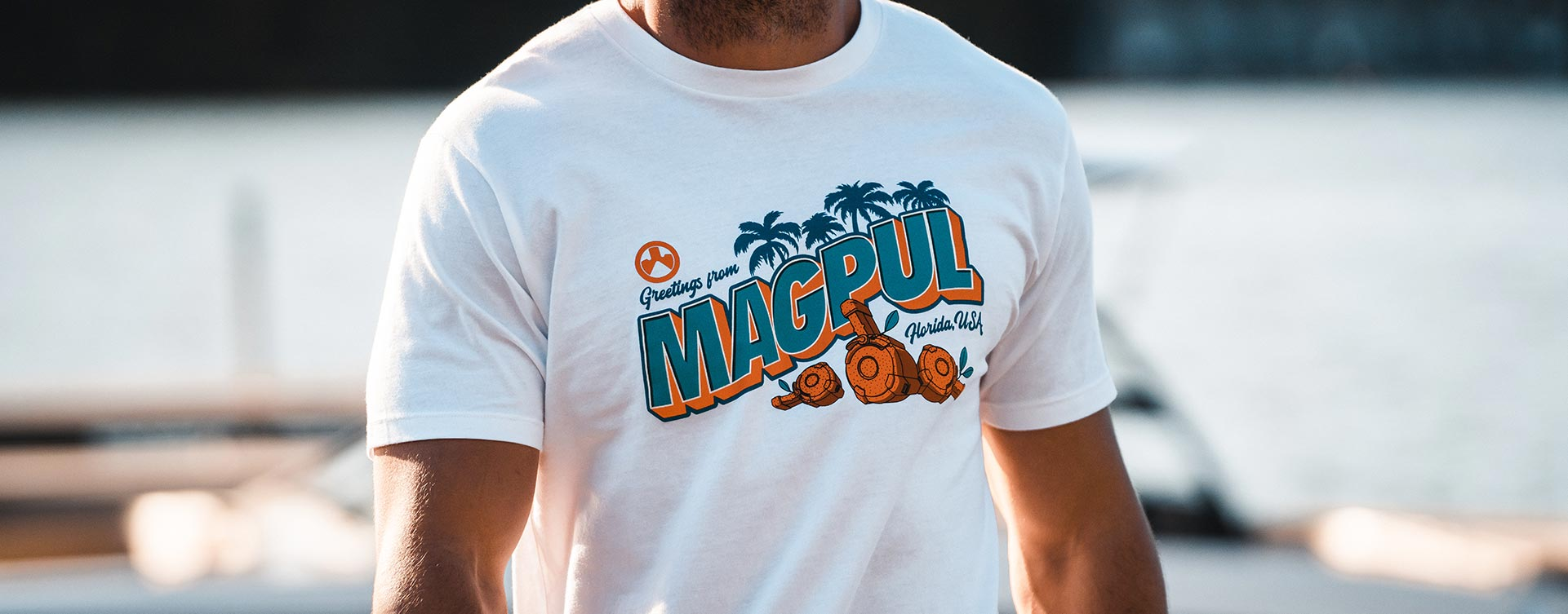 Magpul Fresh Squeezed Freedom CVC T-Shirt on non-descript man outdoors near docked boat
