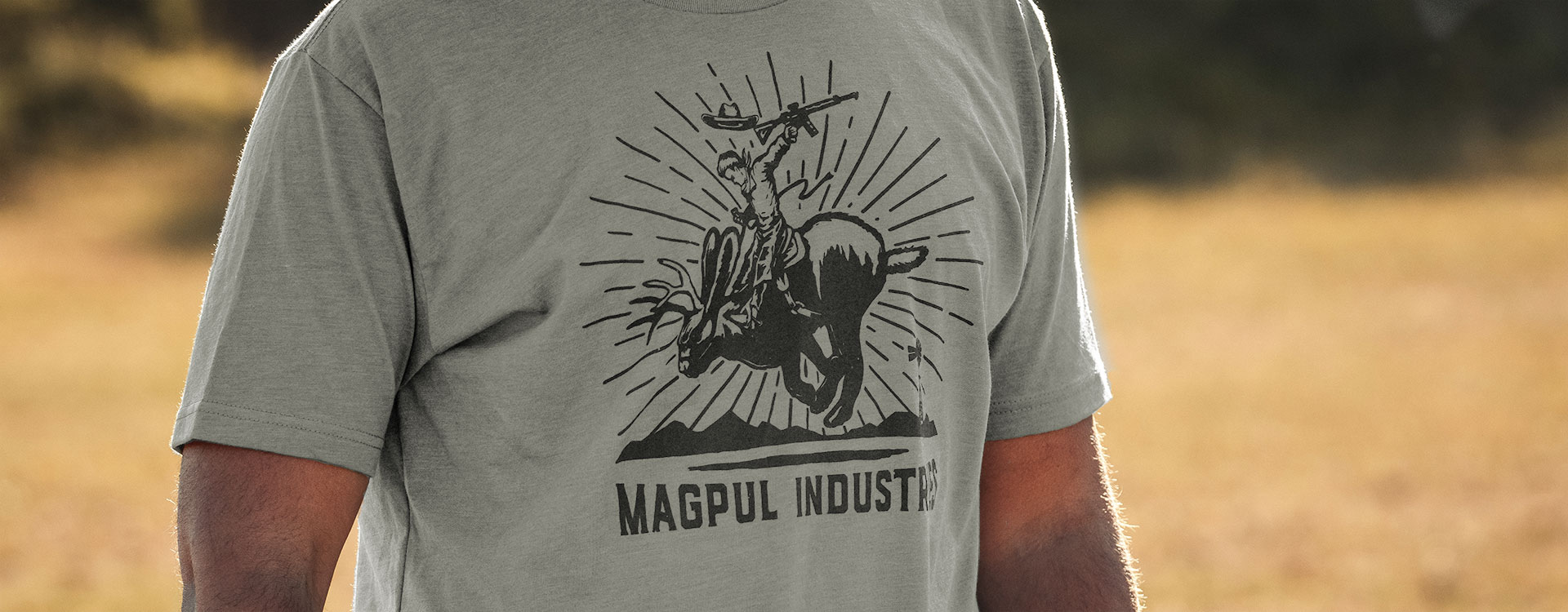 Stone Gray Magpul Jackalope Rodeo CVC T-Shirt worn by an unidentifiable man with a blurred outdoor background