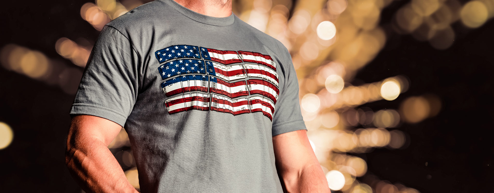 Gray Magpul PFLAG Cotton T-Shirt being worn by man with a firework shell bursting in the background