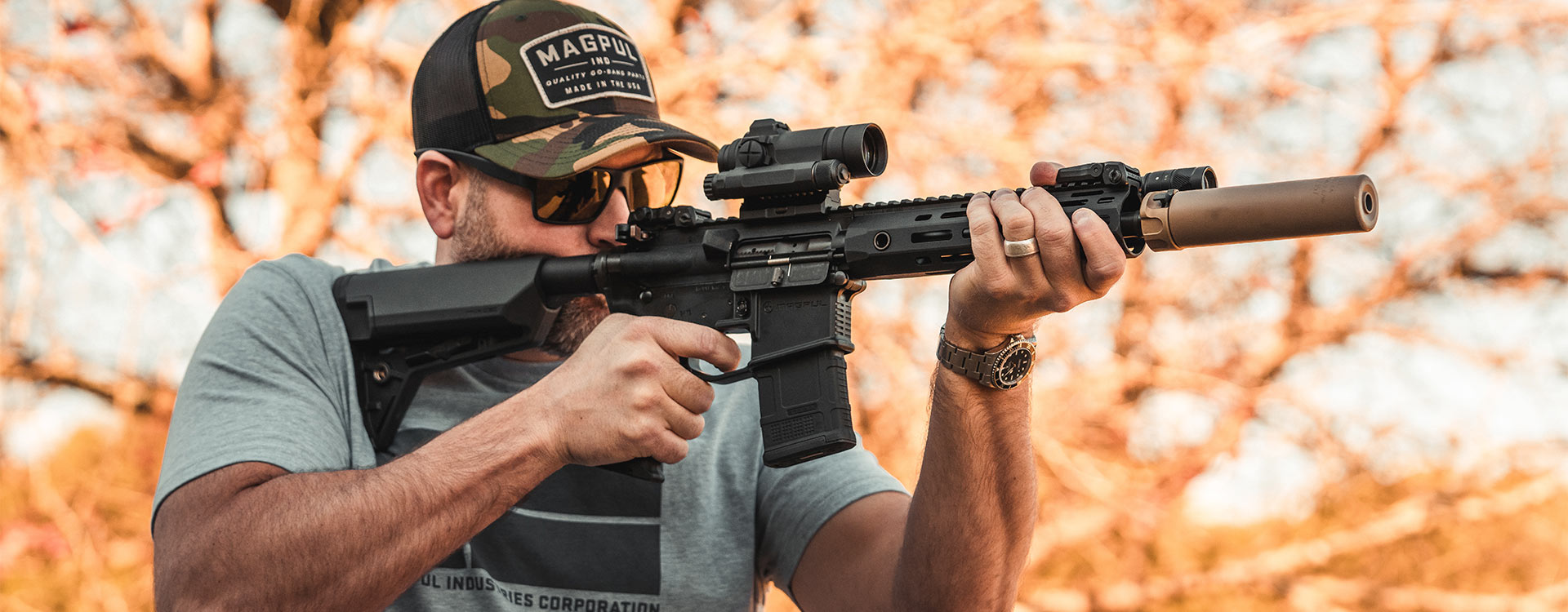 Magpul PMAG 20 AR 300 B GEN M3 in AR15 being shot by a man outdoors wearing a Magpul Hat and Eyewear
