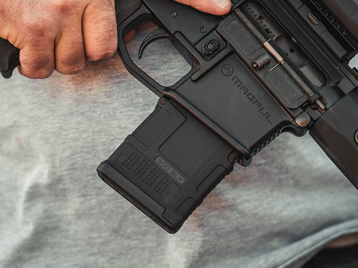 Compact Magpul PMAG 20 AR 300 B GEN M3 in AR15 magwell showing paint pen dot matrix and unique ribbing pattern
