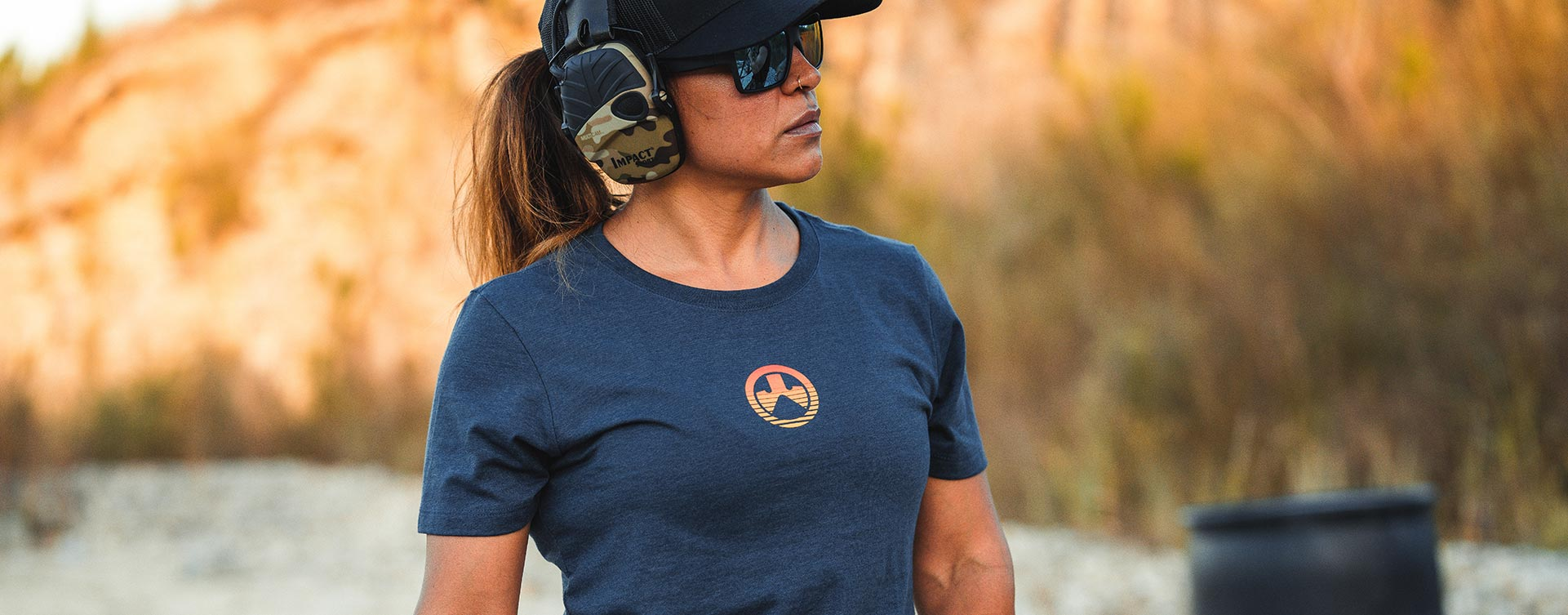 Front of Magpul Women's Sun's Out CVC T-Shirt on female shooter with ear-pro, Magpul Eyewear and hat