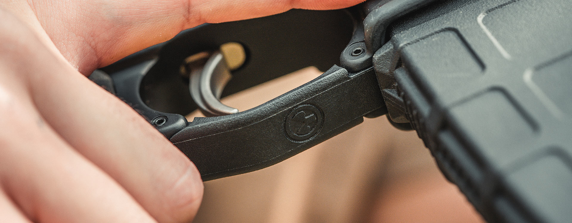 MOE Enhanced Trigger Guard, Polymer installed on an AR15 with Gen M3 PMAG and showing the set screws used for mounting