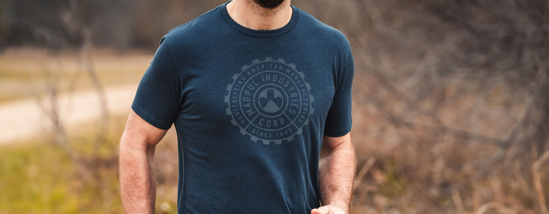 Magpul Manufacturing Blend T-Shirt worn by jogger outdoors with grass and brush background