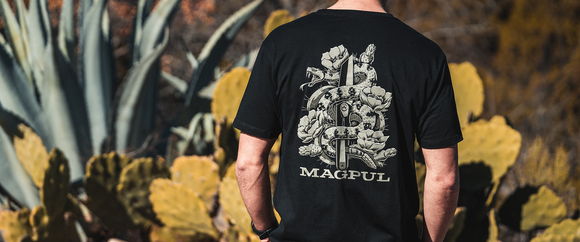 Back of Magpul Diamondback Cotton T-Shirt on man outdoors with large cacti in background