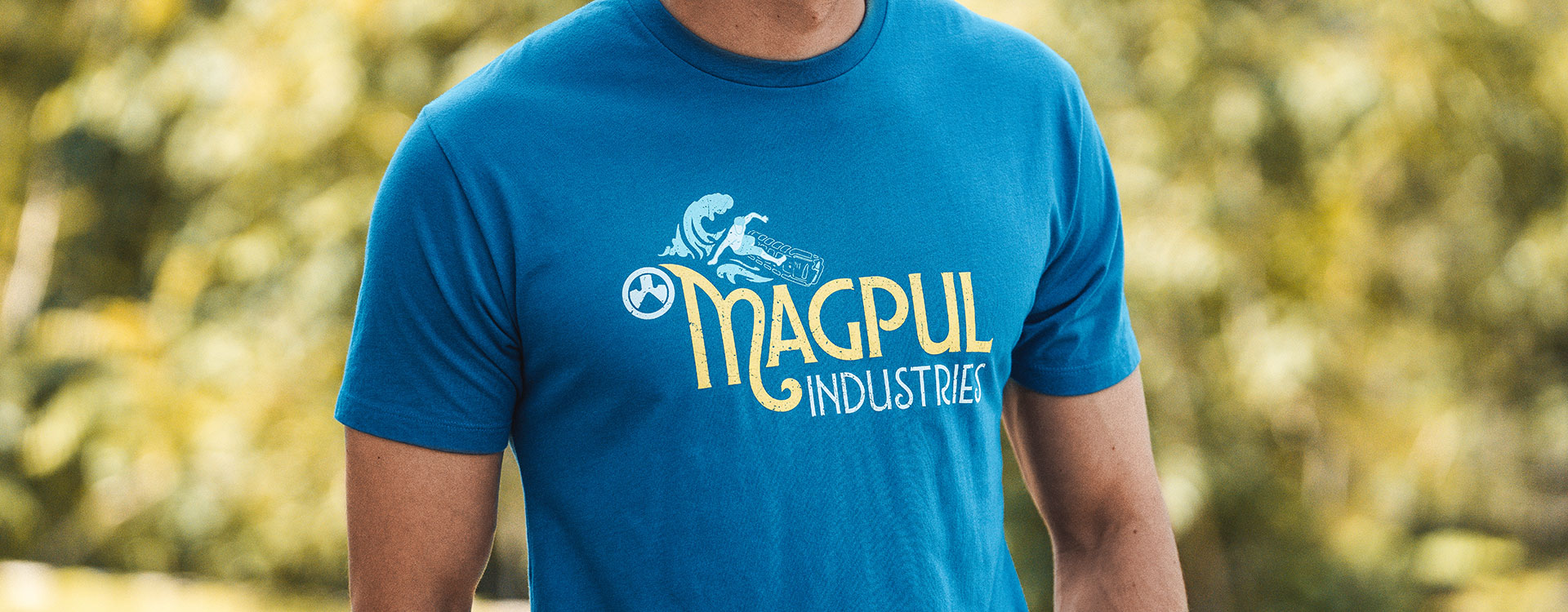 Magpul Hang 30 Blend T-Shirt with graphic of man riding a PMAG surf board worn by man outdoors