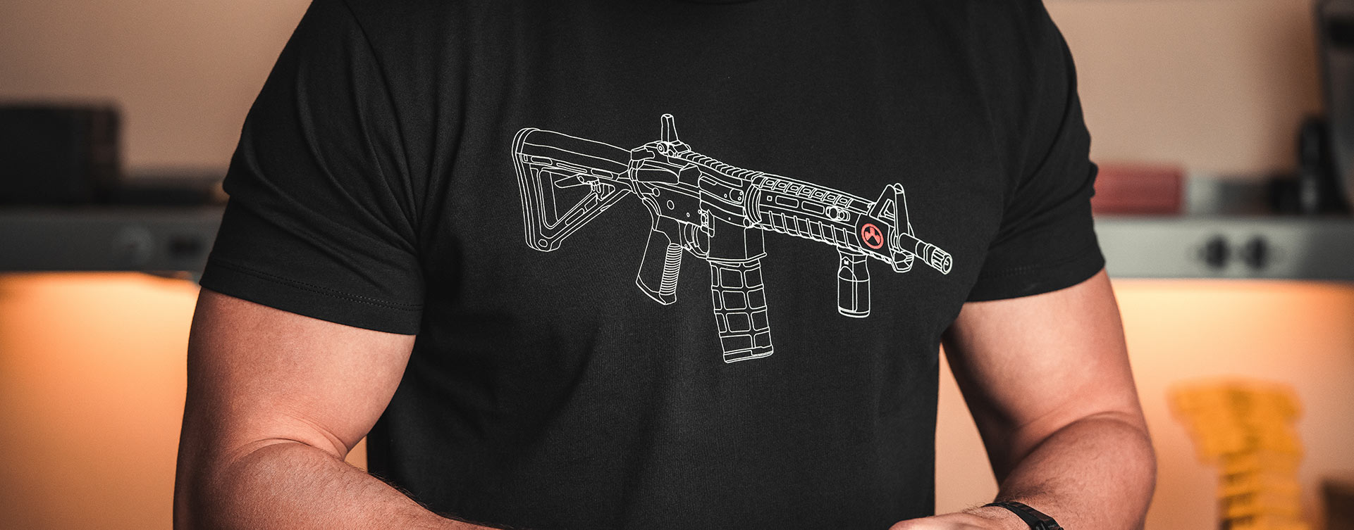 Magpul Blueprint Blend T-Shirt with line art graphic of AR15 with Magpul accessories on man working at workbench