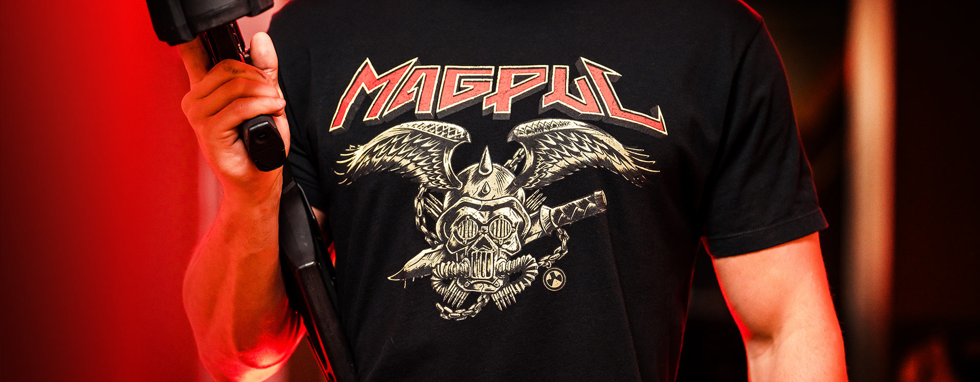 Magpul Heavy Metal Cotton T-Shirt with wicked graphic on man holding AR15 with D-60 Drum PMAG