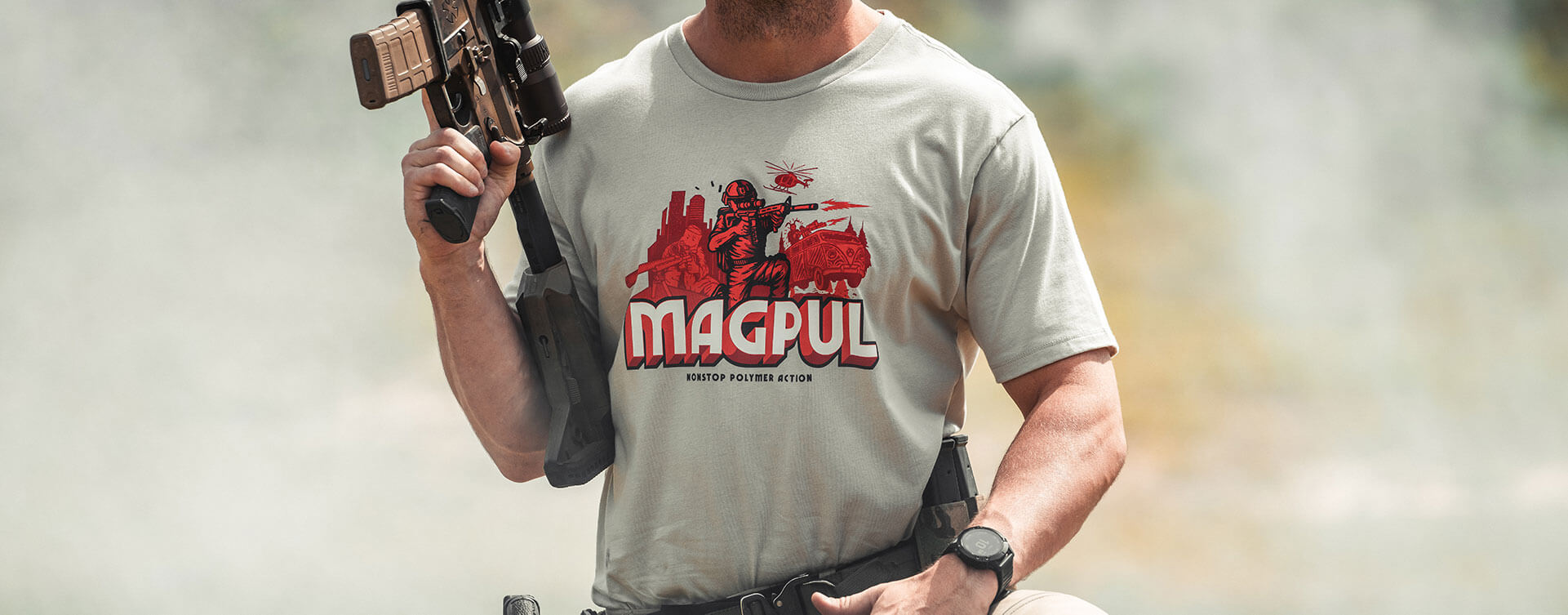 Magpul Nonstop Polymer Action Cotton T-Shirt on man outdoors holding scoped AR and wearing a battle belt