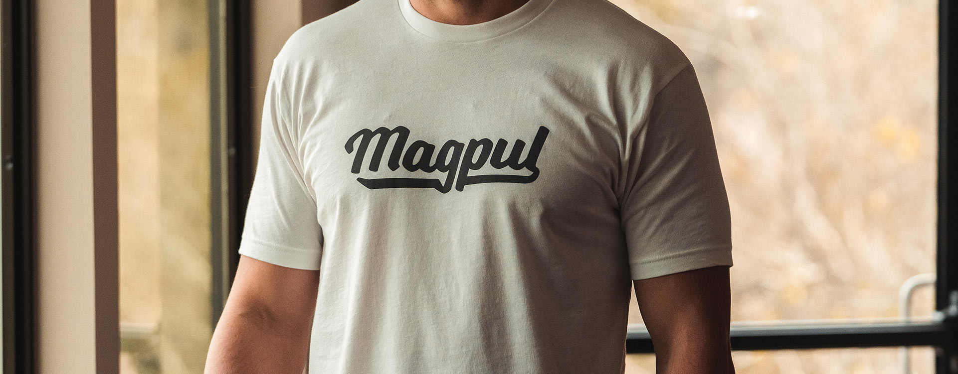 Magpul Script CVC T-Shirt in White with charcoal scripted lettering on man inside