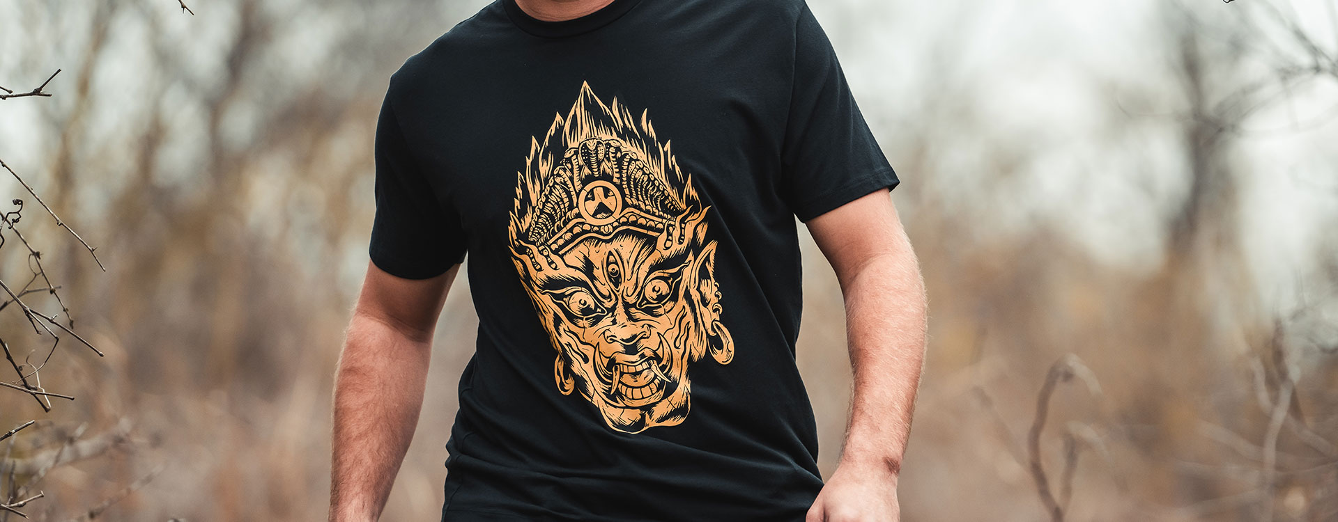 Black Magpul Efreeti Blend Tee with large bronze graphic on front worn by man hiking outdoors