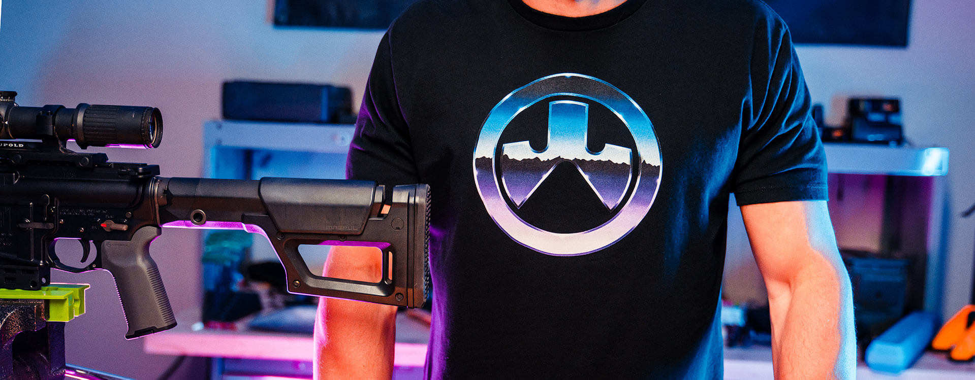 Magpul Chrome Icon Cotton T-Shirt on man in workshop with AR15 in vice with K2 Grip and PRS Lite stock